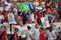 Fans show their support as the U.S. team warms up for an international friendly soccer match against Portugal on Thursday, June 10, 2021, in Houston. (AP Photo/David J. Phillip)