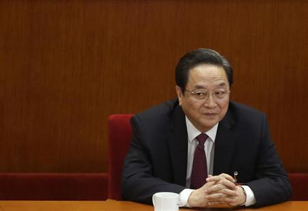 Yu, newly elected chairman of the CPPCC, pauses during a plenary meeting of the CPPCC in Beijing
