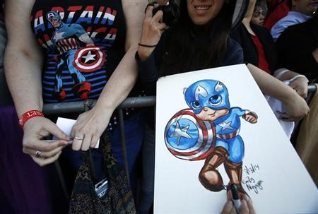 """Fans wait at the premiere of """"Captain America: The Winter Soldier"""" at El Capitan theatre in Hollywood"""