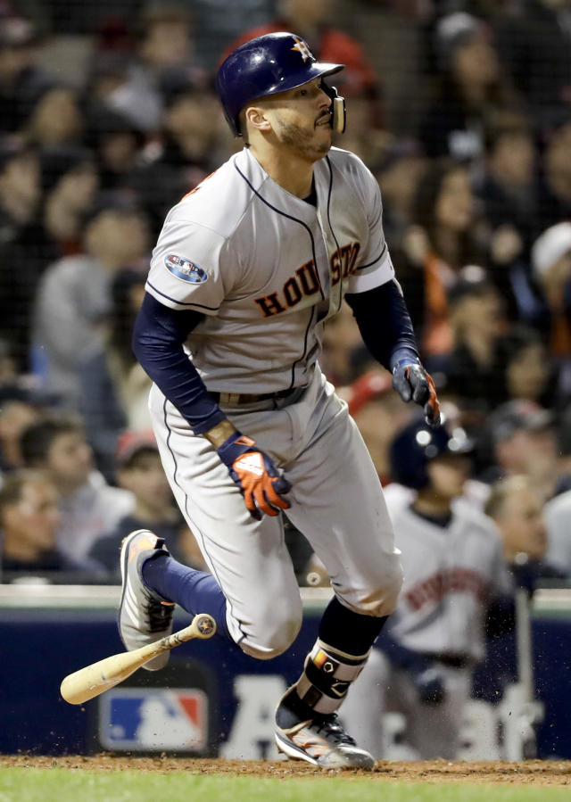 Houston Astros' Carlos Correa watch his RBI-single against the Boston Red Sox during the sixth inning in Game 1 of a baseball American League Championship Series on Saturday, Oct. 13, 2018, in Boston. (AP Photo/David J. Phillip)