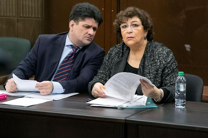 The New Times' editor-in-chief Yevgenia Albats, right, talks with her lawyer before a Moscow court hearing, Nov. 20, 2018. Authorities fined her outlet 22.25 million rubles ($310,000) for failing to disclose foreign income. Albats crowdfunded the money in four days.