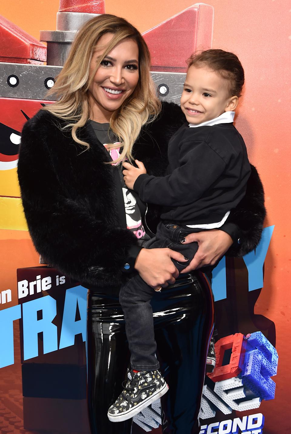 """US actress Naya Rivera and son Josey Hollis Dorsey arrive for the premiere of """"The Lego Movie 2: The Second Part"""" at the Regency Village theatre on February 2, 2019 in Westwood, California."""