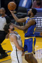 Golden State Warriors forward Andrew Wiggins shoots over Brooklyn Nets forward Joe Harris during the first half of an NBA basketball game in San Francisco, Saturday, Feb. 13, 2021. (AP Photo/Jeff Chiu)