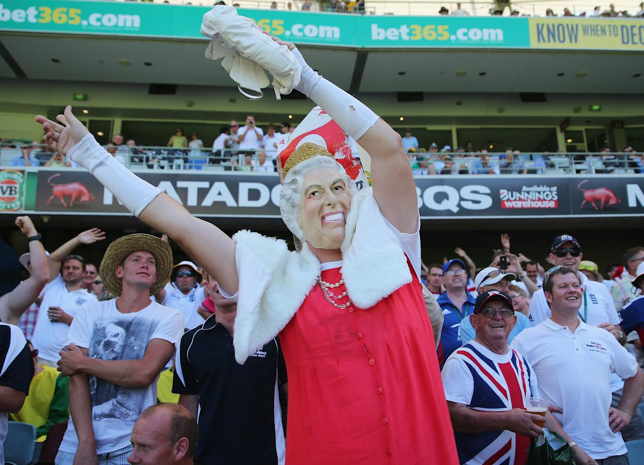 BRISBANE, AUSTRALIA - NOVEMBER 21:  A Barmy Army member dressed as Queen Elizabeth II celebrates after a wicket during day one of the First Ashes Test match between Australia and England at The Gabba on November 21, 2013 in Brisbane, Australia. The Barmy Army is a group of English cricket fans which arranges touring parties for some of its members to support the English cricket team on overseas tours, as well as followers of the team who join in with match day activities in the crowd, but do not travel as part of an organised tour.  (Photo by Scott Barbour/Getty Images)