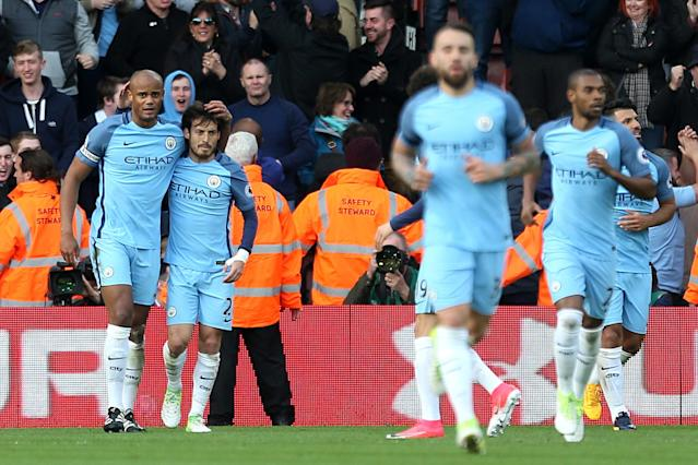 Manchester City's Vincent Kompany (left) celebrates scoring his side's first goal of the game during the Premier League match at St Mary's Stadium, Southampton.