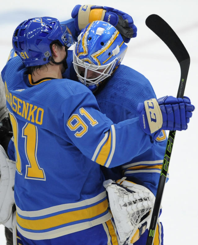 St. Louis Blues' Vladimir Tarasenko (91), of Russia, and goalie Chad Johnson, right, celebrate their victory over the Chicago Blackhawks in an NHL hockey game, Saturday, Oct. 27, 2018, in St. Louis. (AP Photo/Bill Boyce)