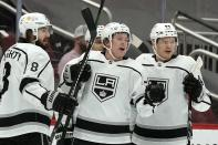 Los Angeles Kings center Jaret Anderson-Dolan, middle, celebrates his goal against the Arizona Coyotes with teammates, including defensemen Drew Doughty (8) and Mikey Anderson (44), during the first period of an NHL hockey game Wednesday, May 5, 2021, in Glendale, Ariz. (AP Photo/Ross D. Franklin)