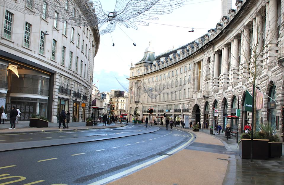 LONDON, UNITED KINGDOM - 2020/12/19: Only a handful of people in Regent Street despite it being closed to traffic. London enters Tier 4 severe restrictions as new Mutant Covid-19 strain is found. The new variant of the virus has been found to be 70% more infectious and is currently rampant throughout London and the South East of England. (Photo by Keith Mayhew/SOPA Images/LightRocket via Getty Images)