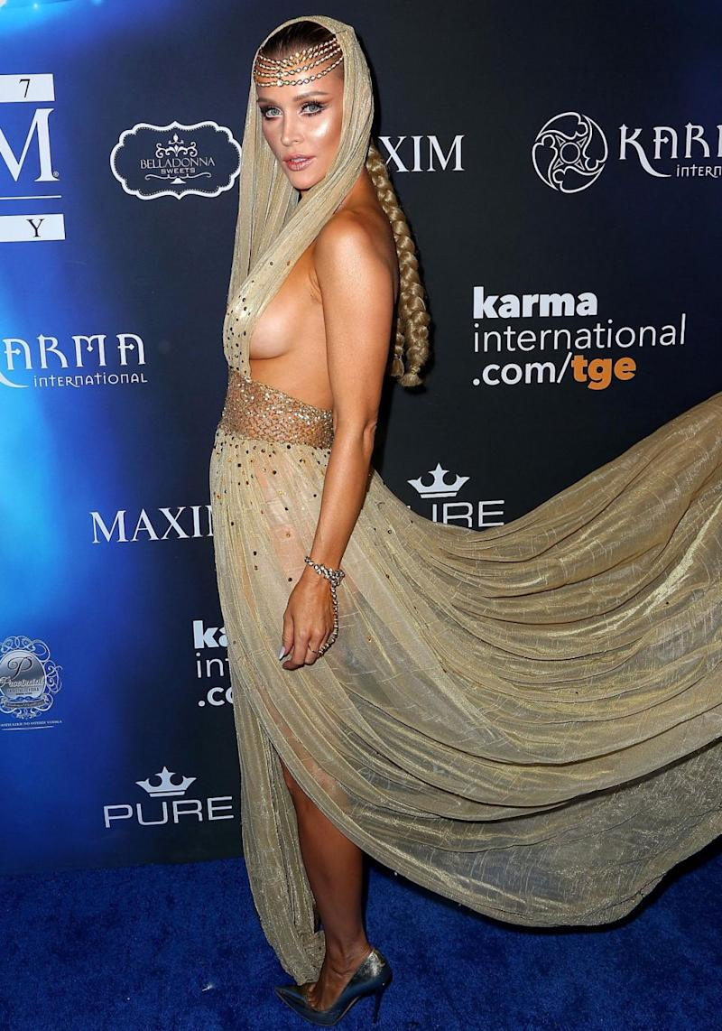 Model Joanna Krupa risked a wardrobe malfunction at the Maxim Halloween Party in LA. Source: Getty