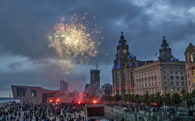 Fireworks go off outside the Liver Building in Liverpool after Jurgen Klopp's side won the Premier League title (Peter Byrne/PA)
