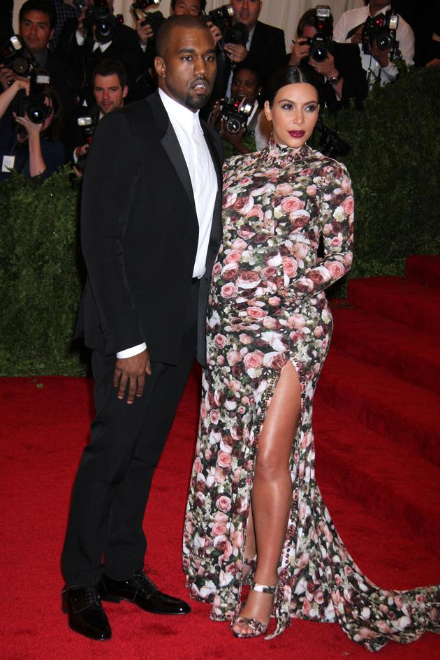 Kim Kardashian won mixed reviews for this floral dress and gloves with a thigh-high split for her appearance at the Met Gala 2013. Copyright [Splash]