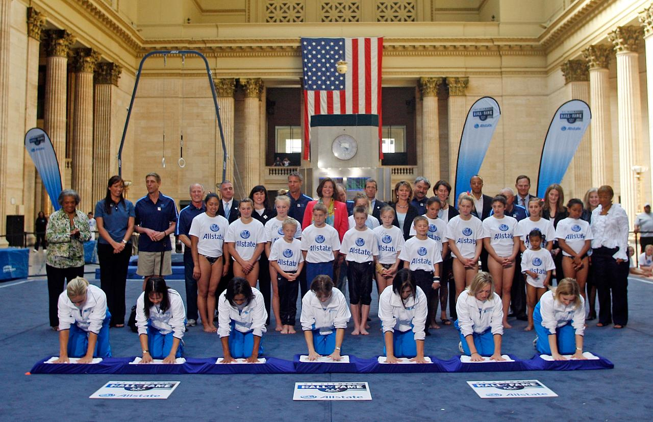 CHICAGO - JUNE 19: (L-R) 1996 Olympics gymnastics gold medalists Amanda Borden, Amy Chow, Dominique Dawes, Shannon Miller, Dominique Moceanu, Jaycie Phelps, and Kerri Strug cast their hand imprints during the AllState US Olympic Hall of Fame Event at Union Station on June 19, 2008, in Chicago, Illinois. (Photo by Jerry Lai/Getty Images for USOC)
