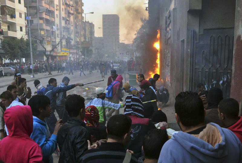 Supporters of Egypt's ousted President Mohammed Morsi damage a police building in Cairo's Ain Shams district, Egypt, Friday, Feb. 7, 2014. Clashes between Egyptian security forces and Islamist protesters left one person dead in a province southwest of Cairo on Friday while two home-made bombs targeting policemen wounded six people in a bridge in the capital, officials said. (AP Photo/Mostafa Darwish)