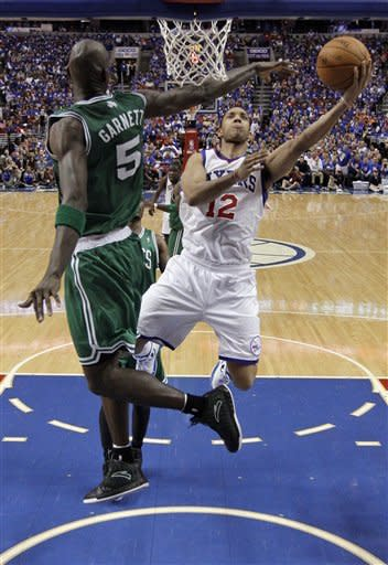 Philadelphia 76ers' Evan Turner, right, goes up for a shot against Boston Celtics' Kevin Garnett during the second half of Game 6 of an NBA basketball Eastern Conference semifinal playoff series, Wednesday, May 23, 2012, in Philadelphia. Philadelphia won 82-75. (AP Photo/Matt Slocum)