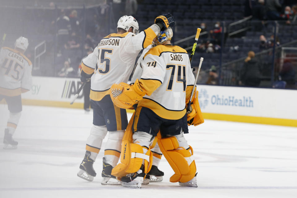 Nashville Predators' Brad Richardson, left, congratulates Juuse Saros after their win over the Columbus Blue Jackets' in an NHL hockey game Monday, May 3, 2021, in Columbus, Ohio. (AP Photo/Jay LaPrete)