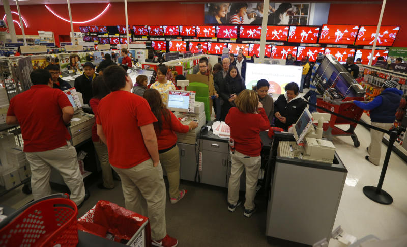 Thanksgiving Day holiday shoppers wait at the checkout lines at the Target retail store in Chicago, Illinois, November 28, 2013. About 140 million people are expected to shop over the four-day weekend, according to the National Retail Federation. REUTERS/Jeff Haynes (UNITED STATES - Tags: BUSINESS)