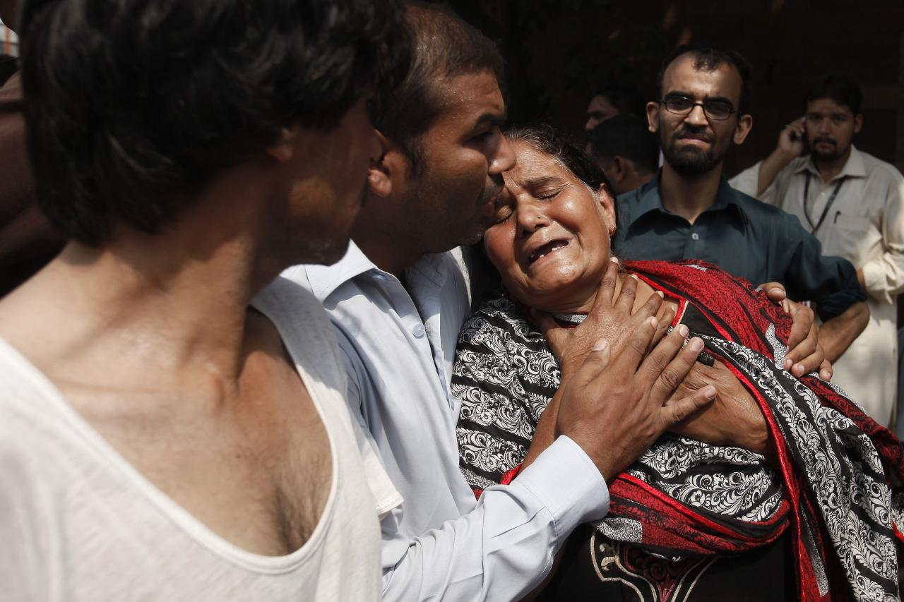 A Christian woman mourns the death of her son at the site of a suicide blast at a church in Peshawar