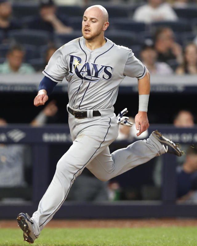 Tampa Bay Rays' Michael Brosseau scores on Yandy Diaz's sixth-inning ground-rule double in a baseball game against the New York Yankees on Tuesday, July 16, 2019, in New York. (AP Photo/Kathy Willens)