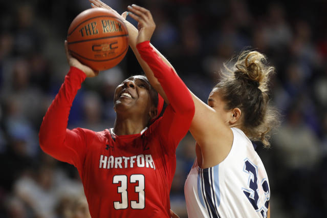 Hartford's Janelle Harrison (33) looks to the net as she is guarded by Maine's Kirsten Johnson in the first half in the America East Conference women's basketball championship, Friday, March 9, 2018, in Bangor, Maine. (AP Photo/Robert F. Bukaty)
