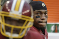 Washington Redskins quarterback Robert Griffin III sits on the bench in the closing minutes of a 27-7 loss to the Tampa Bay Buccaneers in an NFL football game in Landover, Md., Sunday, Nov. 16, 2014. (AP Photo/Patrick Semansky)