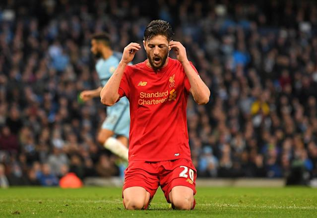 <p>Lallana cannot believe it after missing a simple chance for Liverpool </p>