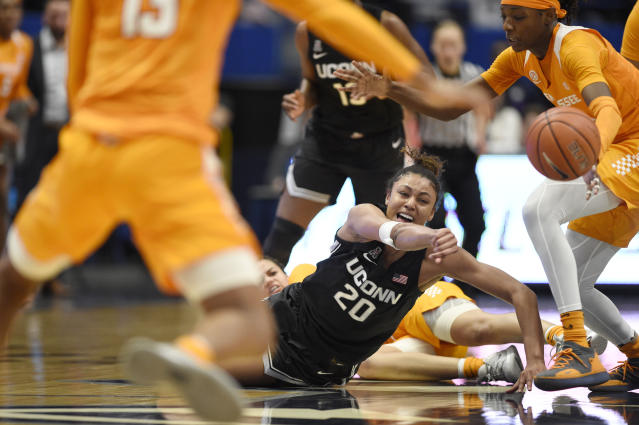 Connecticut's Olivia Nelson-Ododa (20) passes the ball under pressure from Tennessee in the second half of an NCAA college basketball game, Thursday, Jan. 23, 2020, in Hartford, Conn. (AP Photo/Jessica Hill)