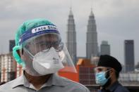 Government medical contract doctors participate in a walkout strike at Kuala Lumpur Hospital amid the coronavirus disease (COVID-19) outbreak in Kuala Lumpur