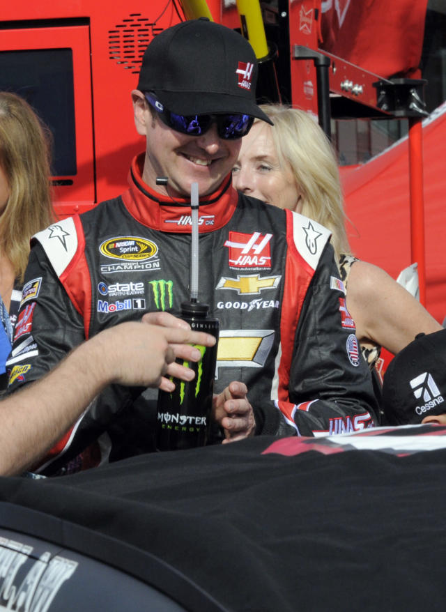 Kurt Busch gets a drink before getting into his car before the start of the NASCAR Sprint Cup series Coca-Cola 600 auto race at Charlotte Motor Speedway in Concord, N.C., Sunday, May 25, 2014. Busch finished sixth in the Indianapolis 500 earlier. (AP Photo/Mike McCarn)