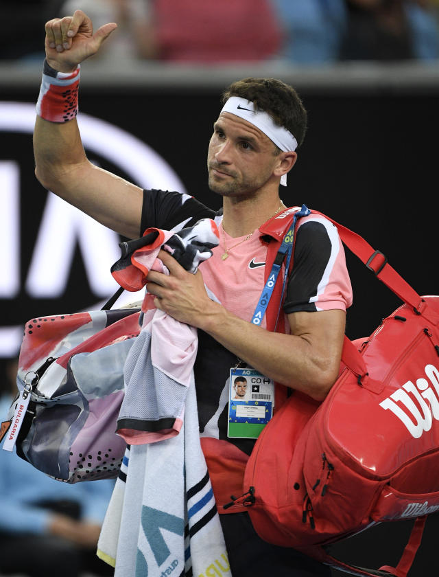 Bulgaria's Grigor Dimitrov gestures to the crowd as he leaves the court following his second round loss to Tommy Paul of the U.S. at the Australian Open tennis championship in Melbourne, Australia, Wednesday, Jan. 22, 2020. (AP Photo/Andy Brownbill)