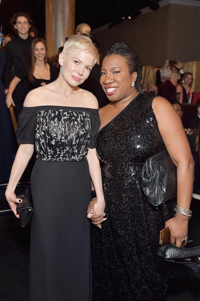 Michelle Williams, left, and Tarana Burke at the Golden Globes Awards. (Photo: Getty Images)