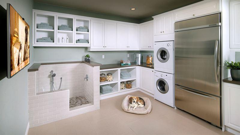 <p>Amenities include appliances like a dedicated washer and dryer, a full-size refrigerator, and a huge, wall-mounted TV. Then there's that remarkable dog bath…<i>(Photo courtesy Lisa Johnson Mandell)</i></p>