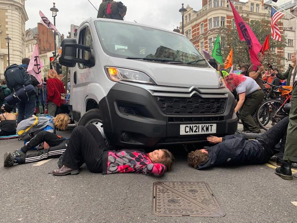 Rose, from Worcester, joins those who have chained themselves to the underside of a van (The Independent)