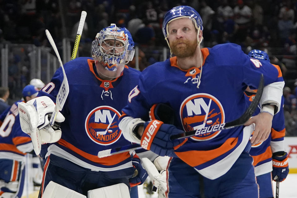 New York Islanders goaltender Semyon Varlamov (40) and right wing Leo Komarov (47) skate off the ice after losing 2-1 to the Tampa Bay Lightning in Game 3 of the NHL hockey Stanley Cup semifinals, Thursday, June 17, 2021, in Uniondale, N.Y. (AP Photo/Frank Franklin II)