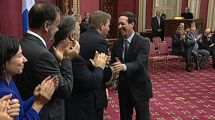 Freshly appointed Treasury Board President Stéphane Bédard, right, shakes hands with cabinet colleagues, from right, Pascal Bérubé (tourism), Daniel Breton (environment), Pierre Duchesne (higher education) and Martine Ouellet (natural resources). Quebec's new cabinet has 23 ministers plus Premier Pauline Marois.