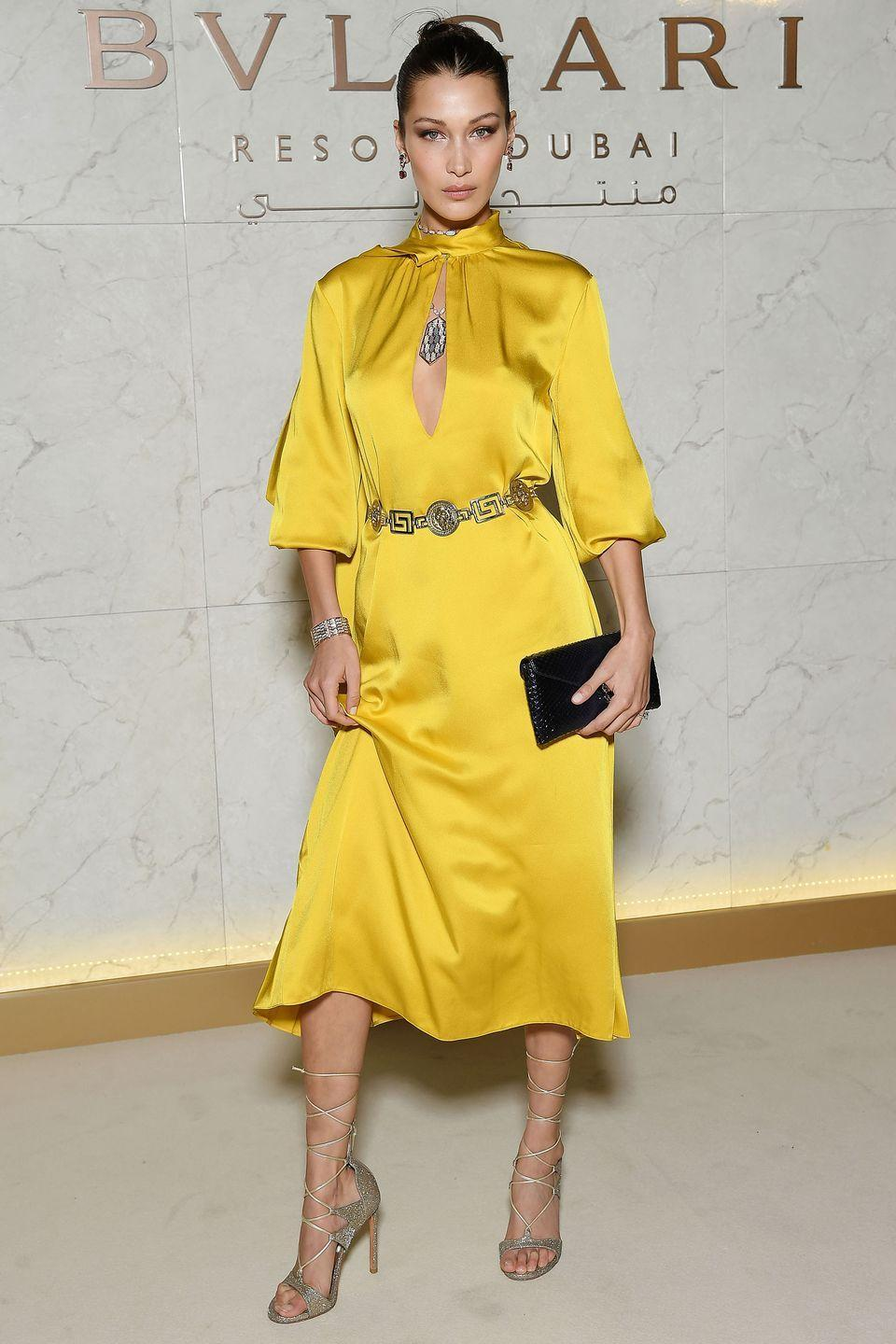 <p>In a golden yellow Fendi silk dress, Stuart Weitzman leg wrap sandals, and a clutch and jewels by Bulgari at the brand's grand opening in Dubai.</p>