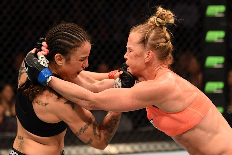 LOS ANGELES, CA - FEBRUARY 28: (L) Raquel Pennington punches Holly Holm in their women's bantamweight bout during the UFC 184 event at Staples Center on February 28, 2015 in Los Angeles, California. (Photo by Josh Hedges/Zuffa LLC/Zuffa LLC via Getty Images)