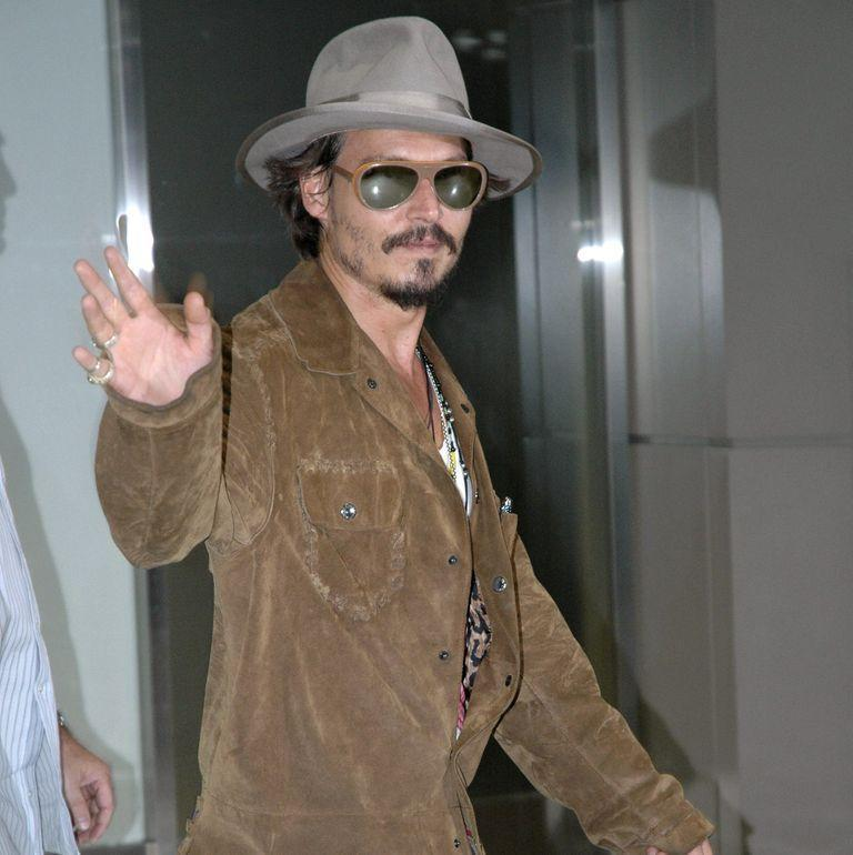 <p>Johnny Depp arrives in Tokyo in 2006 to promote <em>Pirates of the Caribbean: Dead Man's Chest</em>.</p>
