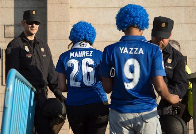 Police officers check Leicester City supporters before the UEFA Champions League quarter final first leg football match Club Atletico de Madrid vs Leicester City at the Vicente Calderon stadium in Madrid on April 12, 2017 (AFP Photo/CURTO DE LA TORRE)