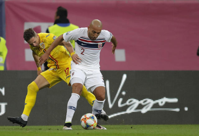 Norway's Haitam Aleesami, right, duels for the ball with Romania's Ciprian Deac during the Euro 2020 group F qualifying soccer match between Romania and Norway on the National Arena stadium in Bucharest, Romania, Tuesday, Oct. 15, 2019. (AP Photo/Vadim Ghirda)