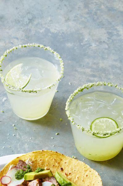 """<p>Nothing says summer like a fresh margarita made with top-notch tequila — whip up a pitcher of this classic version to keep the party going. </p><p><em><a href=""""https://www.goodhousekeeping.com/food-recipes/party-ideas/a28709164/classic-margarita-recipe/"""" rel=""""nofollow noopener"""" target=""""_blank"""" data-ylk=""""slk:Get the recipe for Classic Fresh Lime Margarita »"""" class=""""link rapid-noclick-resp"""">Get the recipe for Classic Fresh Lime Margarita »</a></em></p>"""