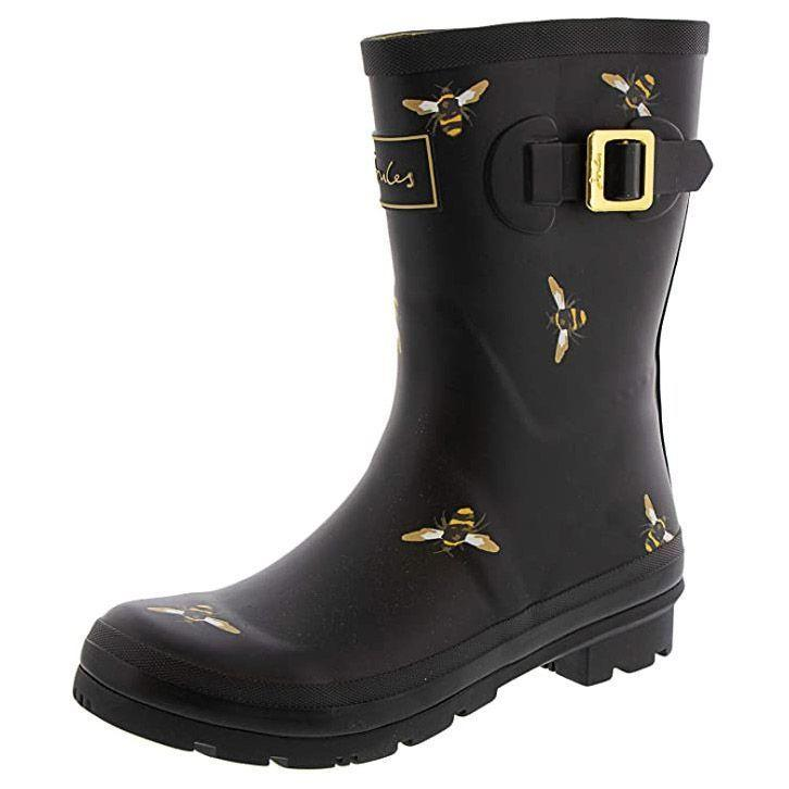 """<p><strong>Joules</strong></p><p>amazon.com</p><p><strong>$64.92</strong></p><p><a href=""""https://www.amazon.com/dp/B07DKPL9D5?tag=syn-yahoo-20&ascsubtag=%5Bartid%7C10055.g.29091176%5Bsrc%7Cyahoo-us"""" rel=""""nofollow noopener"""" target=""""_blank"""" data-ylk=""""slk:Shop Now"""" class=""""link rapid-noclick-resp"""">Shop Now</a></p><p>If you're looking for chic patterns that are more sophisticated, these boots are far from boring yet not too over-the-top. From bees or dogs to stripes or stars, they look upscale while still bringing the fun factor. They also have all the features you want in good boots: fully waterproof rubber, deep treads for traction and an adjustable strap for a good fit.</p>"""