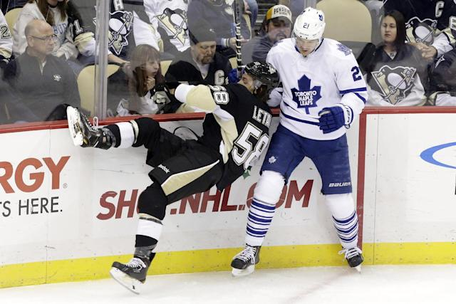 Toronto Maple Leafs' James van Riemsdyk, right, collides with Pittsburgh Penguins' Kris Letang (58) during the first period of an NHL hockey game in Pittsburgh Wednesday, Nov. 27, 2013. (AP Photo/Gene J. Puskar)