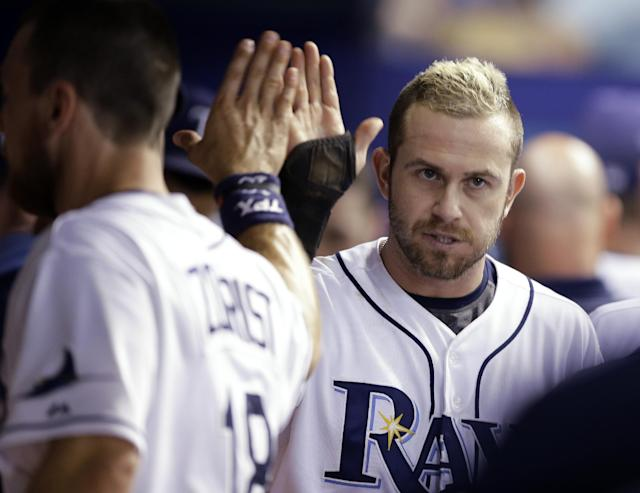 Tampa Bay Rays' Evan Longoria, right, high-fives Ben Zobrist after hitting a three-run double off Boston Red Sox relief pitcher Junichi Tazawa during the seventh inning of a baseball game on Friday, July 25, 2014, in St. Petersburg, Fla. (AP Photo/Chris O'Meara)
