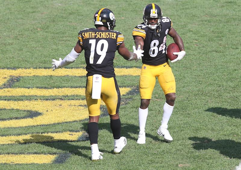 Oct 7, 2018; Pittsburgh, PA, USA; Pittsburgh Steelers wide receiver JuJu Smith-Schuster (19) congratulates wide receiver Antonio Brown (84) on his touchdown against the Atlanta Falcons during the third quarter at Heinz Field. The Steelers won 41-17. Mandatory Credit: Charles LeClaire-USA TODAY Sports