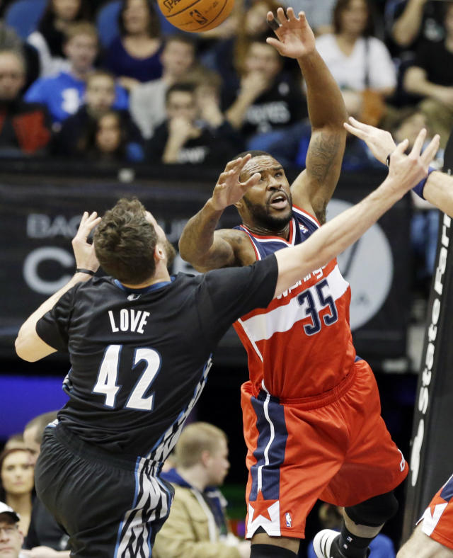 Minnesota Timberwolves' Kevin Love, left, and Washington Wizards' Nene Hilario vie for a rebound during the first quarter of an NBA basketball game, Friday, Dec. 27, 2013, in Minneapolis. (AP Photo/Jim Mone)