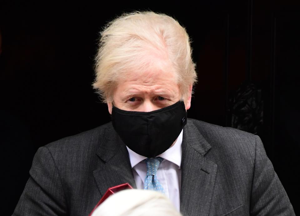 Prime Minister Boris Johnson leaves 10 Downing Street to attend Prime Minister's Questions at the Houses of Parliament, London. Picture date: Wednesday February 10, 2021. (Photo by Ian West/PA Images via Getty Images)
