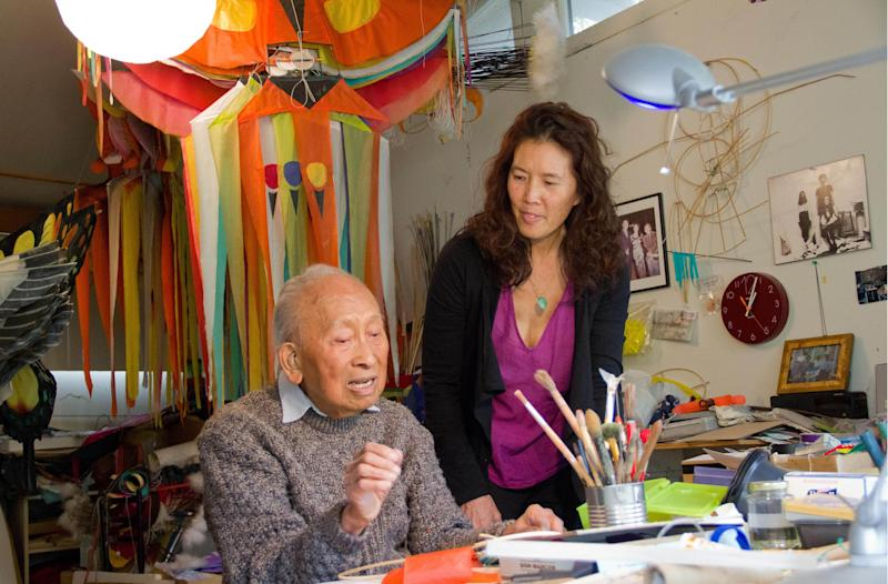 Pamela Tom and Tyrus in Tyrus's kite studio.
