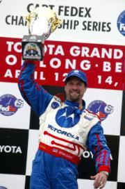 Michael Andretti celebrates his 2002 victory at Long Beach. Mandatory Credit: Donald Miralle/Getty Images