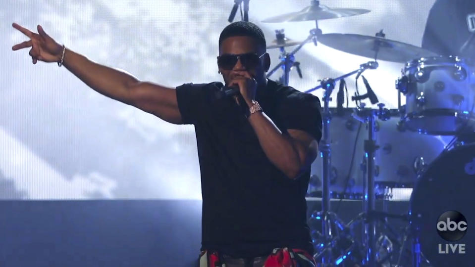 In this screen shot provided by ABC on Sunday, Nov. 22, 2020, Nelly performs a medley at the American Music Awards at the Microsoft Theater in Los Angeles. (ABC via AP)
