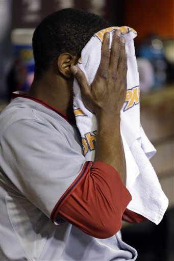 Washington Nationals starting pitcher Edwin Jackson wipes off with a towel as he sits in the dugout after being pulled out of a baseball game during the second against the St. Louis Cardinals on Friday, Sept. 28, 2012, in St. Louis. (AP Photo/Jeff Roberson)